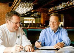 chef and owner looking at resturant reports